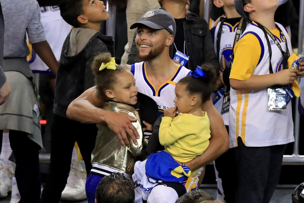 Stephen Curry had his two adorable daughters, Riley and Ryan, by his side after defeating the Cleveland Cavaliers in the NBA Championship in Oakland, CA, on Monday night. After the 29-year-old point guard helped lead the Golden State Warriors to victory at Oracle Arena, he reunited with his family, including wife Ayesha and their gorgeous little girls; Steph held on to 1-year-old Ryan as he celebrated with his team on the podium while 4-year-old Riley showed off her signature charm for the cameras — how cute are their coordinating dresses and bows? Hot on the heels of the Warriors' win came the news that they would not be celebrating with a White House visit, which is customary for championship-winning sports teams. According to multiple reports, the team unanimously decided to boycott a meeting with Donald Trump. Keep reading to see Steph and his family celebrating the Warriors huge accomplishment!