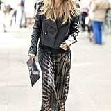 Rachel Zoe topped a printed skirt with a structured, cropped trench and finished the look with her signature oversize shades.