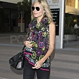 Heidi Klum wore aviator sunglasses and an Exclusively.In scarf.