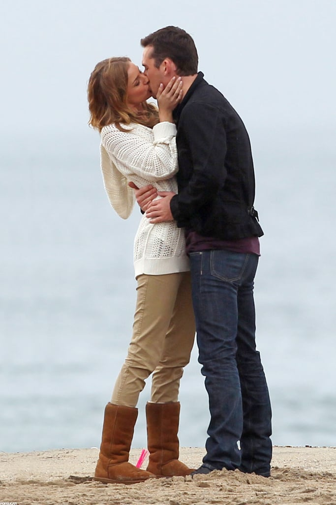 Emily VanCamp embraced her costar Barry Sloane on the rainy LA set of Revenge yesterday. The duo's onscreen romance appears to be heating up, though we'll have to wait until a new episode airs on Sunday for the latest between their characters. Last week's Revenge episode was a flashback to 2006, showing Emily's real-life love, Joshua Bowman, as a college student and Gabriel Mann starting out in business. Gabriel and a few other cast members stepped out last night for the Hollywood Foreign Press Association and InStyle's Golden Globes party, where they chatted with us on the red carpet. Gabriel revealed that he has yet to make plans for New Year's Eve while Christa B. Allen shared her hopes that onscreen mom Madeleine Stowe receive a Golden Globe nomination. Inside the event, Christa posed with Ashley Madekwe, who snapped a picture of them together on Instagram.