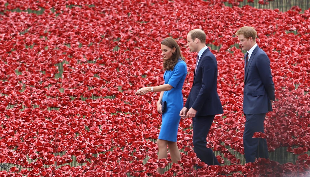 """The Duke and Duchess of Cambridge reunited with Prince Harry on Tuesday, this time back on familiar territory. The group of young royals visited the Tower of London's """"Blood Swept Lands and Seas of Red"""" installation in the Tower's moat, which was created to commemorate the 100th anniversary of the beginning of World War I. It will eventually hold 888,246 ceramic red poppies, each representing every British and British colonial loss of life during the Great War. On Monday, The Duchess of Cambridge, Prince William, and Harry were also busy with marking the special anniversary, with Kate and Wills attending Le Memorial Interallie in Liege, Belgium, alongside Belgium's Queen Mathilde and King Philippe and French President Francois Hollande. Harry was on his own earlier in the day when he stopped by an unveiling of a memorial in Folkestone, England, but he later met up with his brother and sister-in-law in Belgium to visit the St. Symphorien Military Cemetery.  While the royal family is busy with duties surrounding World War I, they will soon break from their work for a Summer holiday. Most of the family usually travels to Balmoral Castle to unwind for the month of August. Kate, Will, and son George are expected to make a stop by the estate for riding, hunting, fishing, and general relaxing. However, the royals' September schedules are already filling up, with Kate planning on making her first solo royal tour to Malta on Sept. 20 (no word yet on if George will join her). Meanwhile, Harry is hard at work preparing for the launch of his Invictus Games, which will take place from Sept. 10-14. The Games are a big deal to Harry, as they are aimed at supporting and showcasing wounded servicemen and women. Harry said he got the idea after visiting the Warrior Games in the United States back in 2013."""