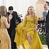 Pictured: Olivia Munn, Amanda Seyfried, and Thomas Sadoski