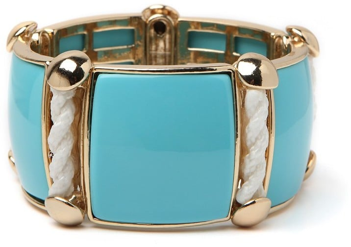 This crisp lucite cuff has a laid-back luxe that we love — and the subtle rope detail is nautical chic without being too over the top. BaubleBar Sky Rope Cuff ($52)