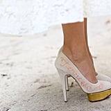 Charlotte Olympia's heels lent luxe and whimsy to this ladylike look.