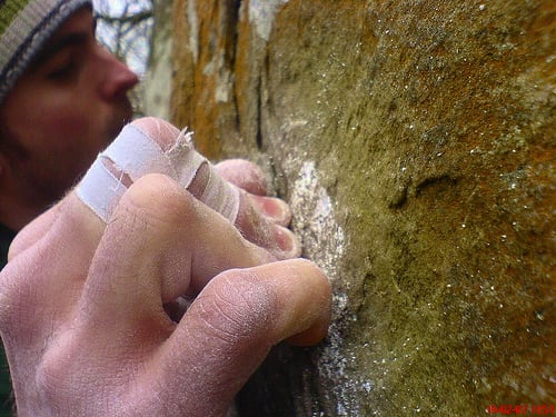 Definition: Crimping, rock climbing, grip