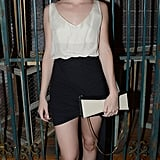 Christa B. Allen tucked an off-white v-neck tank into a black miniskirt, then coordinated a matching bow bag and black pumps at the Revenge wrap party.