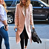 Jessica Alba stepped out wearing a pair of black skinny jeans, which she paired with a pink coat, a Bassike top, and a Rebecca Minkoff bag.