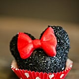 Minnie Mouse cake pops were taken off the stick and placed in cupcake liners so they'd be easier for the kids to eat.