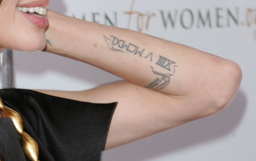 Roman Numeral on Her Left Forearm