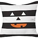 وسادة Hide And Seek Halloween من علامة DENY Designs ومن تصميم زوي وودارز– سوداء اللّون (بسعر 49.99$ دولار أمريكيّ؛ 184 درهم إماراتيّ؛ ريال سعودي)