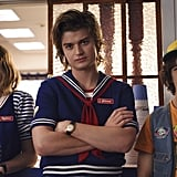 "So when Stranger Things dropped an '80s-tastic teaser for the new season way back in July 2018, it left many fans scratching their heads. The 90-second teaser doesn't bother answering any lingering questions from season two; instead, it introduces a new shopping mall for the town of Hawkins, which is where Steve now works at a nautical-themed ice cream shop. (We much prefer him in babysitter mode, but looks like his friendship with Dustin is still going strong!) Both the teaser and this photo show a glimpse of actress Maya Hawke, who plays a mysterious new character named Robin who happens to work with Steve. Netflix's previously released description of the character mentioned that ""she seeks excitement in her life and gets more than she bargained for when she uncovers a dark secret in Hawkins, IN,"" so we can only imagine what the two of them will get up to."