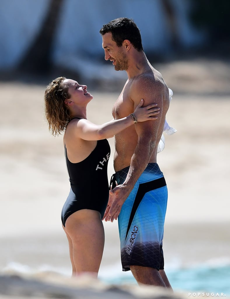 Hayden Panettiere cozied up to her fiancé, boxer Wladimir Klitschko, during a family beach day in Barbados on Wednesday. The couple were joined by their 3-year-old daughter, Kaya, and were all smiles as they hung out in the ocean; Wladimir was in fighting shape in a pair of blue swim trunks, while Hayden slipped into a black one-piece swimsuit. She and Wladimir first got together in 2009, split briefly two years later, and resumed their relationship (with an engagement!) in 2013.  Hayden is just one of a handful of celebrity moms who have been open about their struggles with postpartum depression; the actress entered treatment twice after giving birth to Kaya in 2014 and seems to be stronger than ever. Hayden currently stars on the CMT series Nashville, which is in its sixth and final season.       Related:                                                                                                           Hayden Panettiere Has 1 of the Most Inspiring Celebrity Evolutions