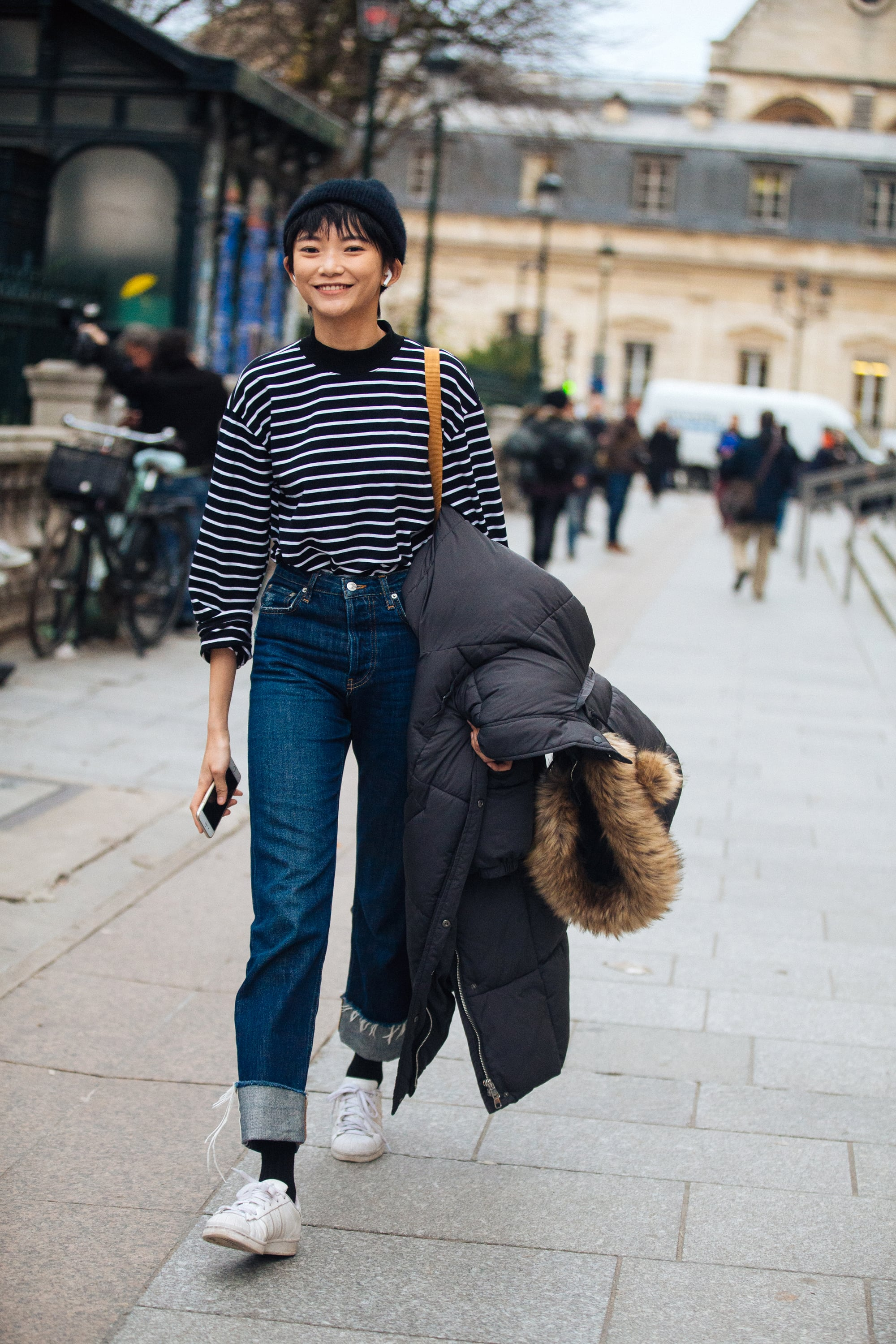 A striped shirt, jeans and sneakers are