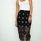 With a Sheer, Printed Skirt, a Statement Necklace, and Shoes With Silver Details