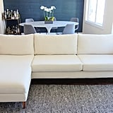 "Next, I substituted the basic Ikea cover for a custom cover from Bemz, a Swedish company that specializes in high-end Ikea slipcovers. I chose the Porridge Linara by Romo, and got the Karlstad three seater sofa cover ($549) and chaise add on cover ($249).  Choosing a slipcover for an Ikea piece comes with many practical benefits. For one, they're machine washable — so I could feel good about that light color. Bemz also produces their custom covers on demand, which helps cut down on waste, making them eco-friendly. In addition, the company uses quality, natural fabrics, like linens and cotton. ""We think our products are extremely affordable for something that is custom made,"" founder Lesley Pennington tells us. They have 300 fabrics to choose from."