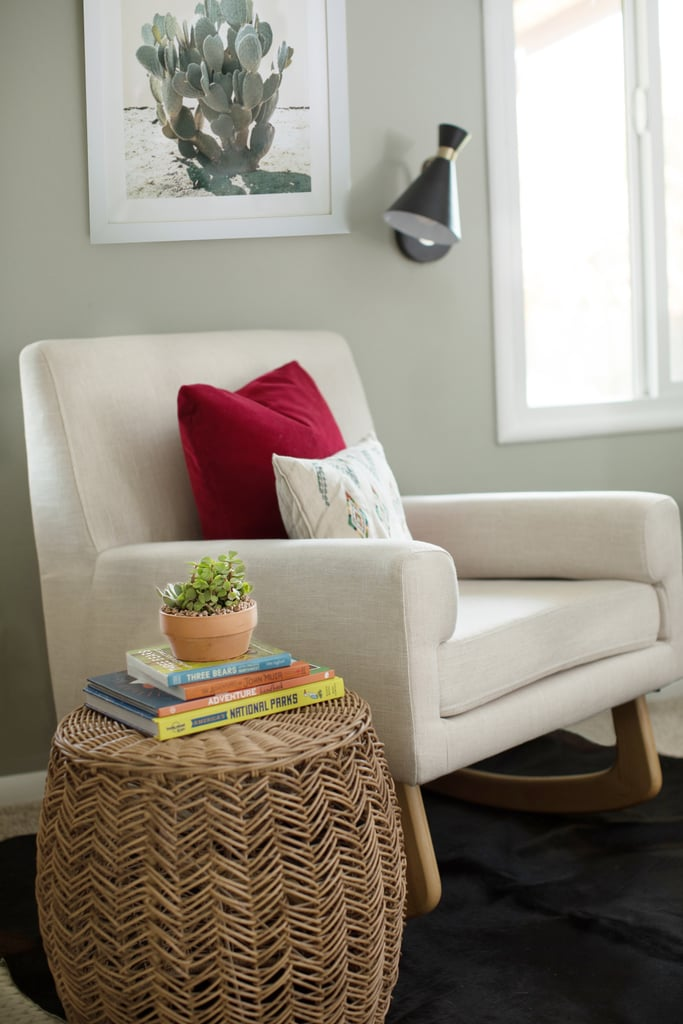 Instead of having our blue club chair against the larger wall next to the closet, Briana placed this cream-colored rocking chair ($500) in the more narrow space between the windows. This freed up the wall next to the closet for another piece of storage furniture.