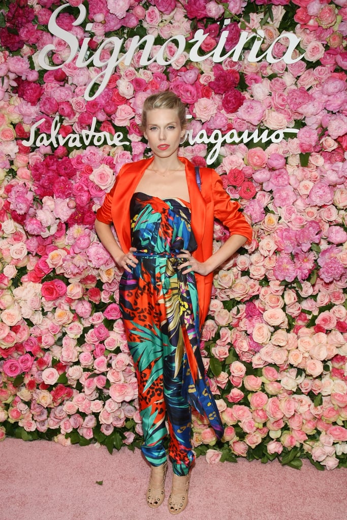 Theodora Richards didn't skimp on the brights or festive florals in a silky jumpsuit.