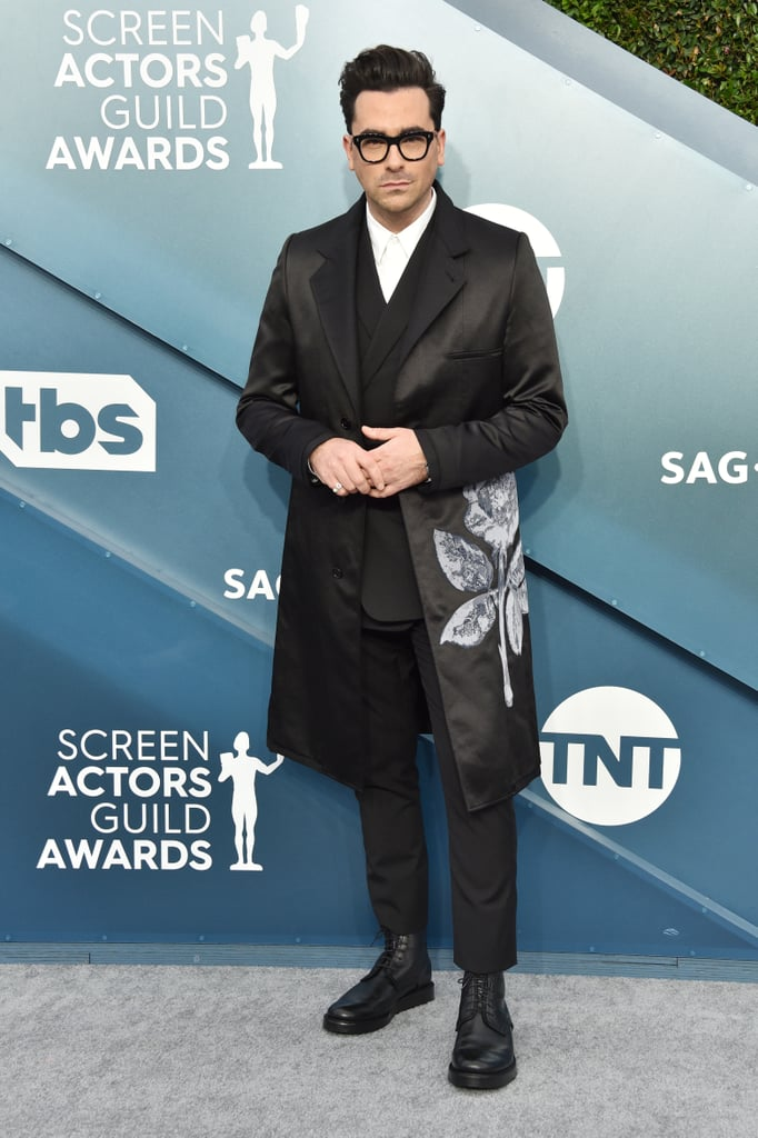 Dan Levy made a subtle, yet sweet, reference to his Schitt's Creek family during the SAG Awards on Sunday night. The 36-year-old actor wore an embroidered jacket on the red carpet that featured a beautiful rose on its left side. According to fashion journalist Booth Moore, Dan and his stylist Erica Cloud chose this Dior outerwear specifically to honor the onscreen Roses from his Pop TV show. Dan's character, David Rose, has an especially keen eye for unique clothing items, so I have a feeling he'd approve of this sentimental pick. Ahead, see more photos of Dan's carefully-chosen homage.