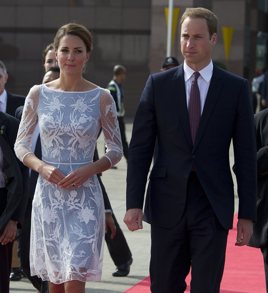 We can't get over how sweet and feminine the floral appliqué details of her Temperley London dress are — and Prince William looks quite dapper, too.