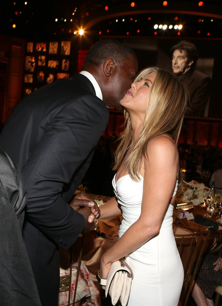 Jennifer Aniston greeted Dennis Haysbert at the AFI Life Achievement Award dinner honouring Shirley MacLaine in LA.