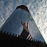 An American flag waves against Freedom Tower on the 10th anniversary of 9/11.