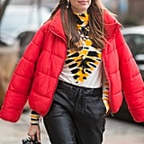 Why settle on only one colorful item when you can mix and match more than one with a tie-dye turtleneck and bright red puffer on top?