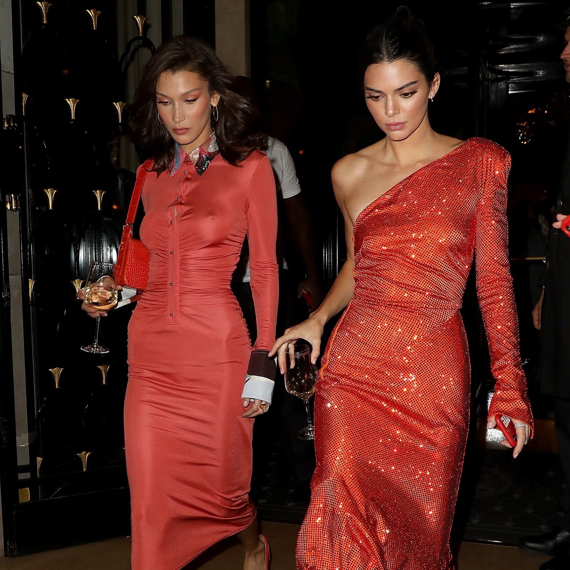 39b65e6fe243 Kendall Jenner and Bella Hadid in Orange Dresses in Paris