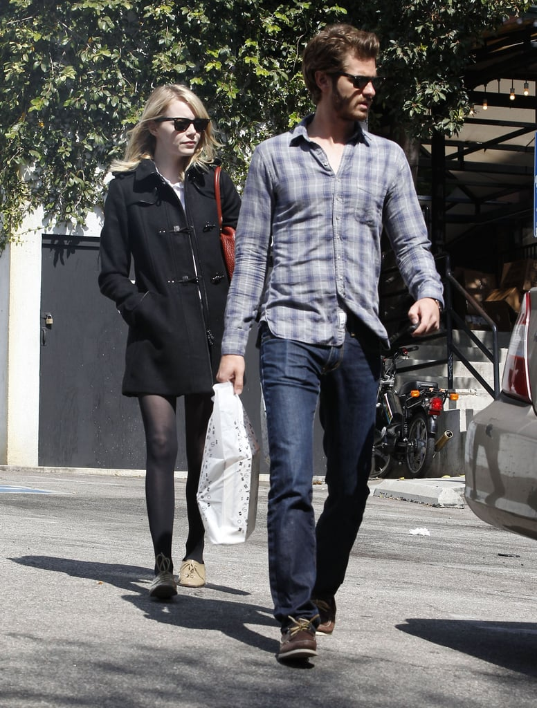 Emma Stone and Andrew Garfield caught up on errands in LA yesterday and were spotted leaving Book Soup with newly purchased reading material. Emma returned to the West Coast over the weekend following a trip to Paris. She was in the City of Light for this year's Paris Fashion Week. Emma sat front row at Miu Miu on Tuesday, and later in the week toured the gardens at the Musée Rodin with a friend. Back at home, Andrew had an exciting week as well. Columbia Pictures announced director Marc Webb and Andrew will return for the Amazing Spider-Man sequel, with plans to begin production early next year. Emma's character may also return, though it's still not official.