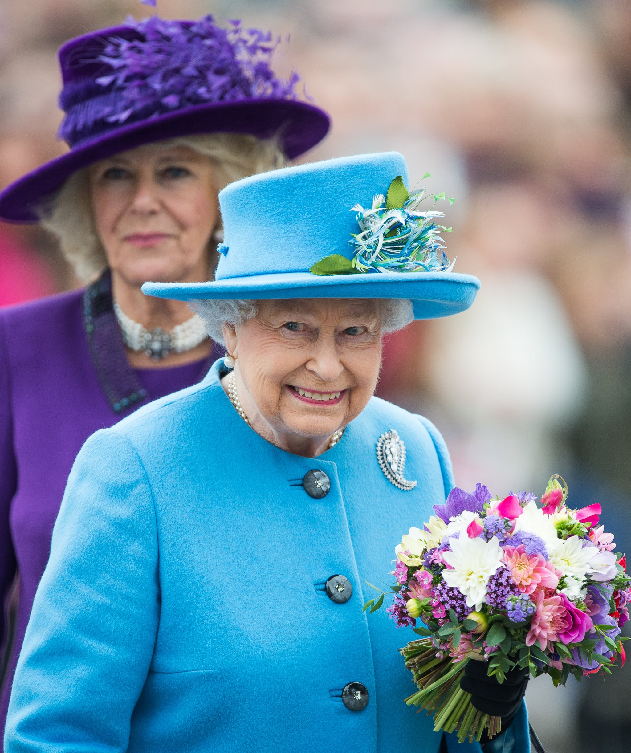 POUNDBURY, DORSET - OCTOBER 27:  Queen Elizabeth II and Camilla, Duchess of Cornwall tour Queen Mother Square on October 27, 2016 in Poundbury, Dorset.  (Photo by Samir Hussein/WireImage)