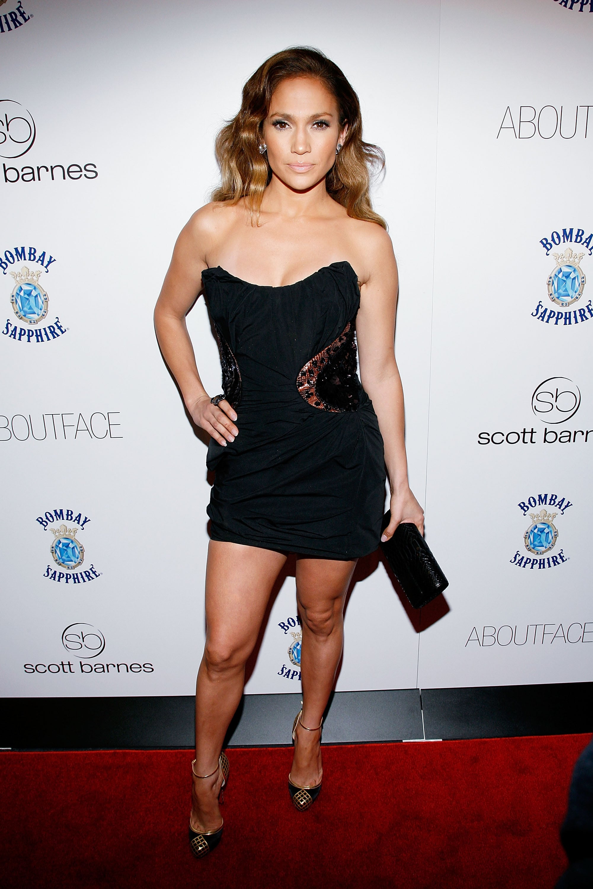 Short and super sexy in a black strapless at a book launch party in 2010.