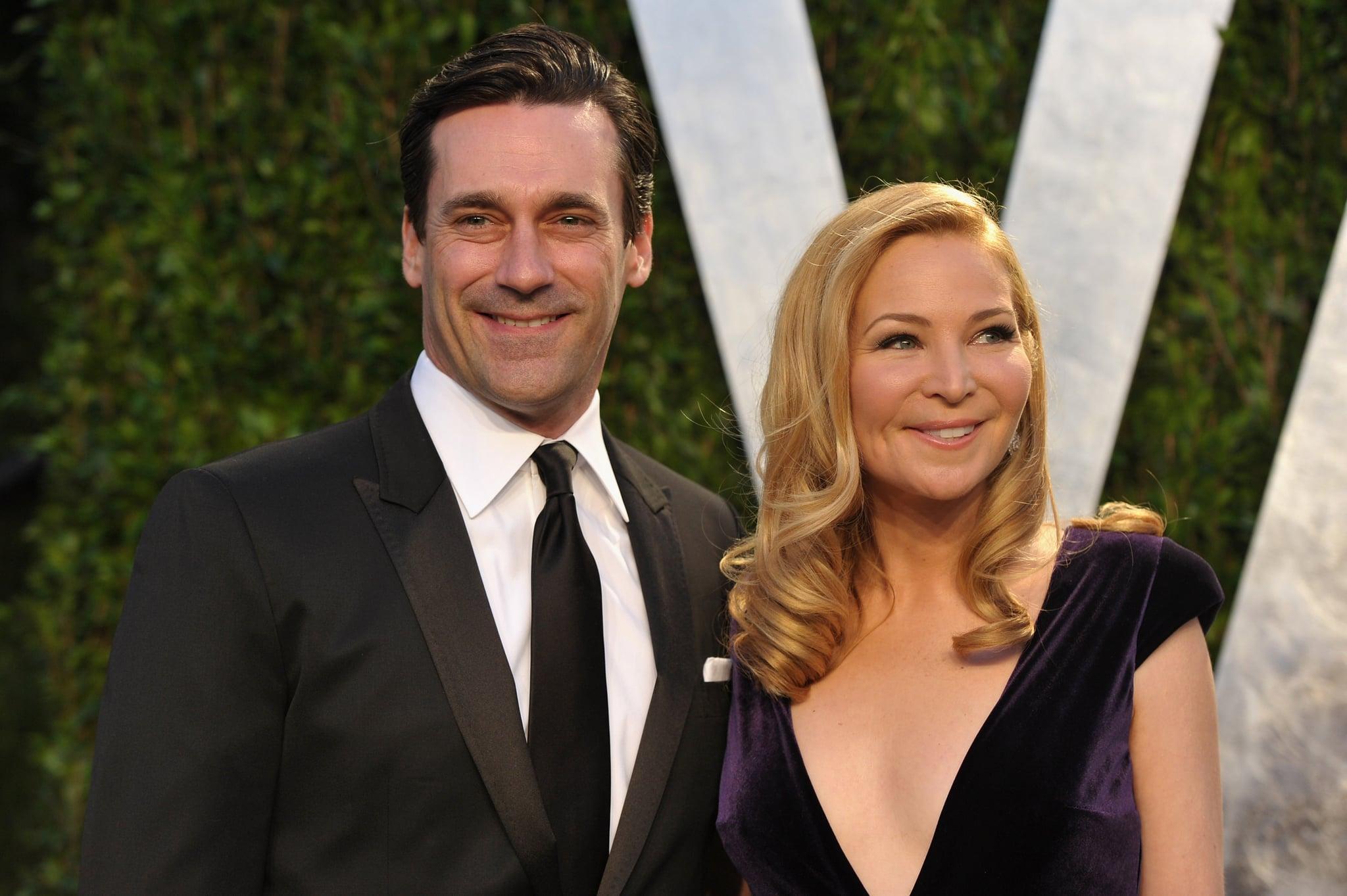 John Hamm and Jennifer Westfeldt smile at Vanity Fair Oscar party.