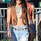 Kendall played up her look with key accessories, including chunky silver necklaces and bracelets, a concho belt, a neutral fringed crossbody bag, and rimless aviator sunglasses.