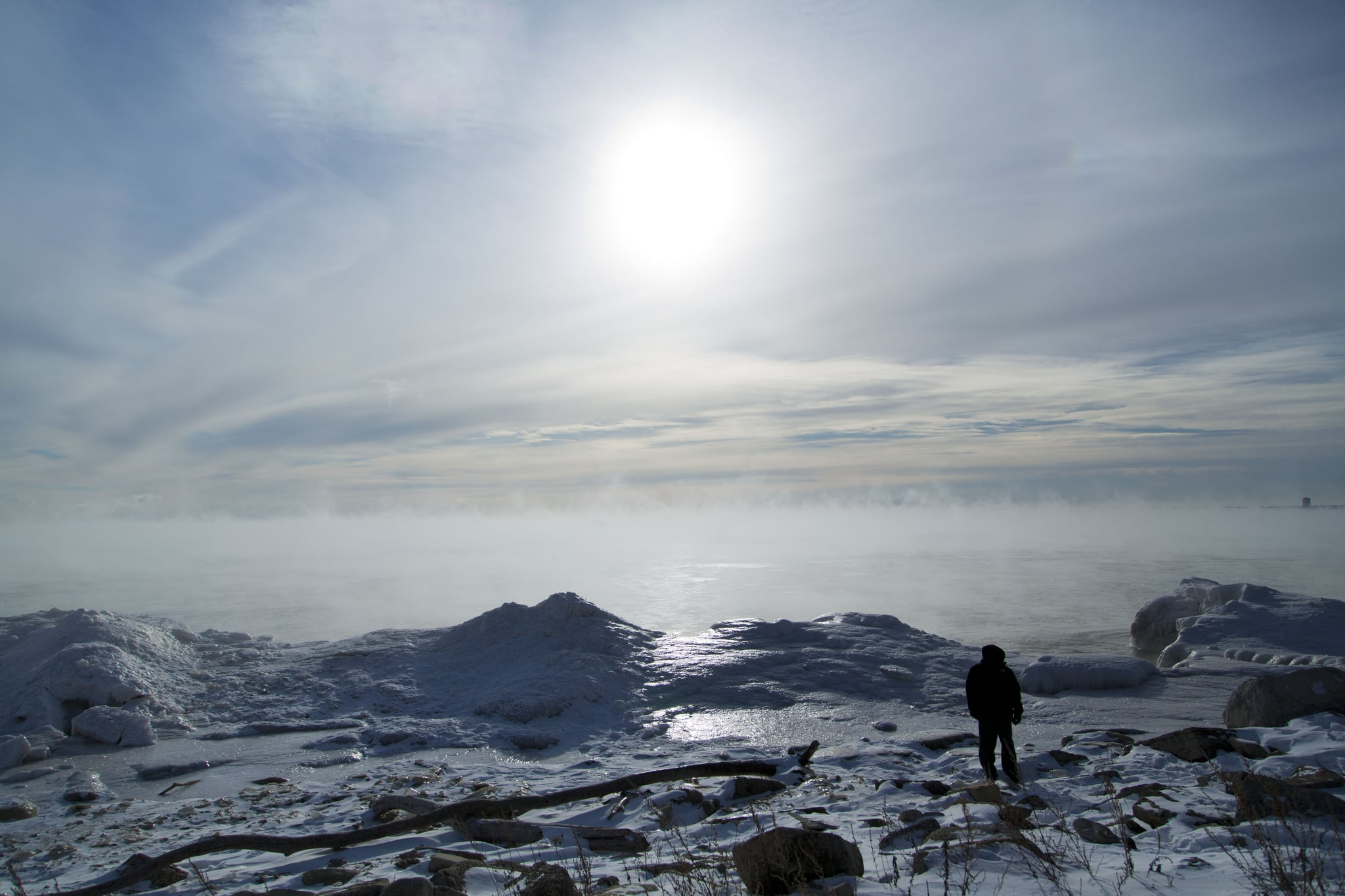 A man in Milwaukee, WI, walked along the shore of Lake Michigan.