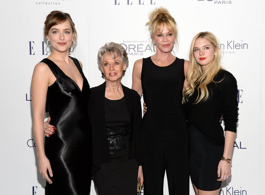 Dakota Johnson had a few gorgeous family members by her side at the Elle Women in Hollywood Awards in LA on Monday night. The Fifty Shades of Grey star was joined at the event by her mom, Melanie Griffith, her 19-year-old sister Stella Banderas, and her grandmother, legendary actress Tippi Hedren; the fierce foursome posed for photos together on the red carpet before heading inside, and Dakota was the picture of elegance as she accepted the Calvin Klein emerging star award and snapped pictures with the brand's creative director, Francisco Costa.  Dakota hasn't shied away from talking about her famous family, especially when it comes to their opinions of her scandalous role in the Fifty Shades films. While promoting the movie last year, Dakota revealed that her mom still refuses to watch it, and Melanie, along with Dakota's dad, Don Johnson, popped up in the front row for a hilarious movie reference during Dakota's SNL hosting gig back in March. Dakota hasn't slowed down since playing Anastasia Steele, either; she recently starred in Black Mass with Johnny Depp, and her sexy French film remake A Bigger Splash comes out next May. Keep reading to see all the photos of Dakota and her stunning relatives, then check out more celebrities with their loved ones at award ceremonies.