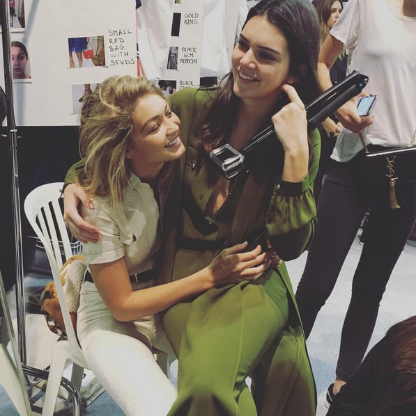 "Gigi and Kendall posed for a candid shot backstage at Elie Saab during hair and makeup. ""Love, friendship, and ELIE SAAB. That's what it's all about,"" Elie Saab wrote on Instagram."