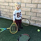 Jessica Simpson's son, Ace, helps put away the gear after a family tennis game.