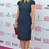 Amy Poehler contrasted her formfitting, cap-sleeved blue sheath by David Meister Signature with red peep-toe pumps and a sparkly red clutch.