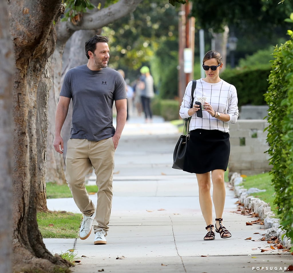 Everyone's been so flabbergasted by Angelina Jolie and Brad Pitt's divorce news this week, and we couldn't be more relieved to see another high-profile former Hollywood couple, Ben Affleck and Jennifer Garner, stepping out together looking smiley and happy. The estranged pair have a history of keeping things amicable for the sake of their three kids, and they were spotted walking side by side and having a spirited conversation in LA on Thursday. Ben and Jen recently linked up to celebrate their children's first day of school and were also photographed having an in-depth chat while bringing the little ones to a neighborhood block party over the weekend. As you mourn the romance between Brad and Angie, hopefully these photos of Ben and Jen keeping a united front will help you through the pain.