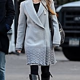 Jessica Biel paired a gray coat with black boots.