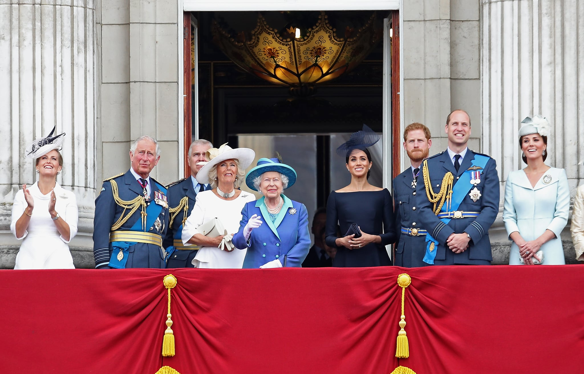 LONDON, ENGLAND - JULY 10:  (L-R) Prince Charles, Prince of Wales, Prince Andrew, Duke of York, Camilla, Duchess of Cornwall, Queen Elizabeth II, Meghan, Duchess of Sussex, Prince Harry, Duke of Sussex, Prince William, Duke of Cambridge and Catherine, Duchess of Cambridge watch the RAF flypast on the balcony of Buckingham Palace, as members of the Royal Family attend events to mark the centenary of the RAF on July 10, 2018 in London, England.  (Photo by Chris Jackson/Getty Images)