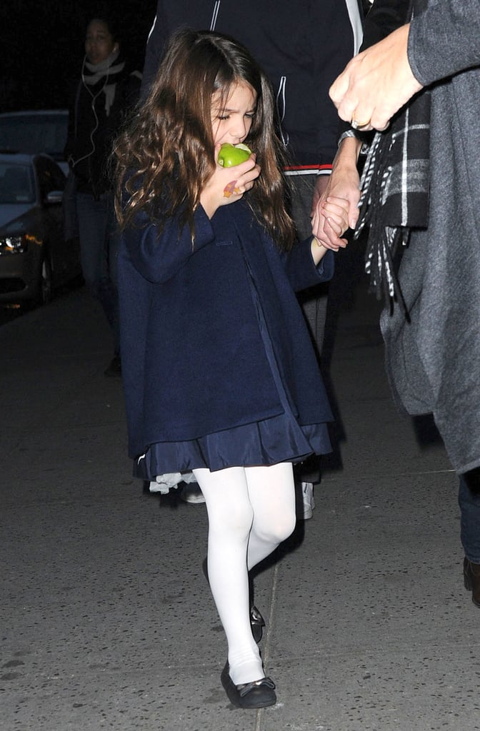 Suri Cruise ate an apple as she left her mom Katie Holmes's Broadway show.