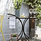 "An adorable outdoor bar cart like this one makes it easy to entertain outdoors.  And when hosting guests al fresco, Jamie prefers to serve unfussy bites and libations. ""Start with easy finger foods, seasonal fruits, and cocktails. The fewer plates, the better,"" she explains."