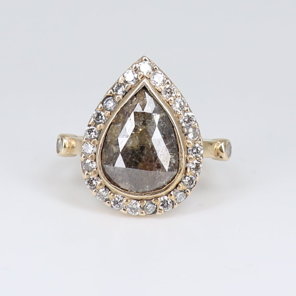 PS: What stones are the most popular? Laura: We really specialise in using unique stones that are not traditionally thought of when one might hear 'engagement ring'. I think grey diamonds are a beautiful alternative for a non traditional bride. I also love designing with moonstone and rutilated quartz as no two are alike. PS: What do you think the biggest engagement ring trends will be for next year? Laura: I think there has been a real move away from traditional white diamonds, more women are turning to alternate rings that really express their style, so I do think we are going to be seeing more people flaunting gorgeous stones with colour. PS: What is the biggest mistake people make when buying an engagement ring? Laura: You don't need to spend the earth and offer up your first born child in order to have a stunningly beautiful ring to cherish your love story with. more money doesn't always mean better quality, so do your research.   Shop the ring here.