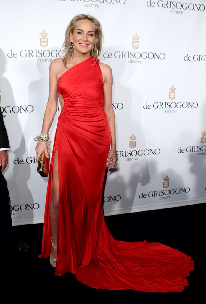 Sharon Stone celebrated at the de Grisogono party in a red-hot, one-shoulder gown.
