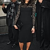 Paula Patton showed off her cute baby bump in a black lace dress before heading into the Michael Kors show.