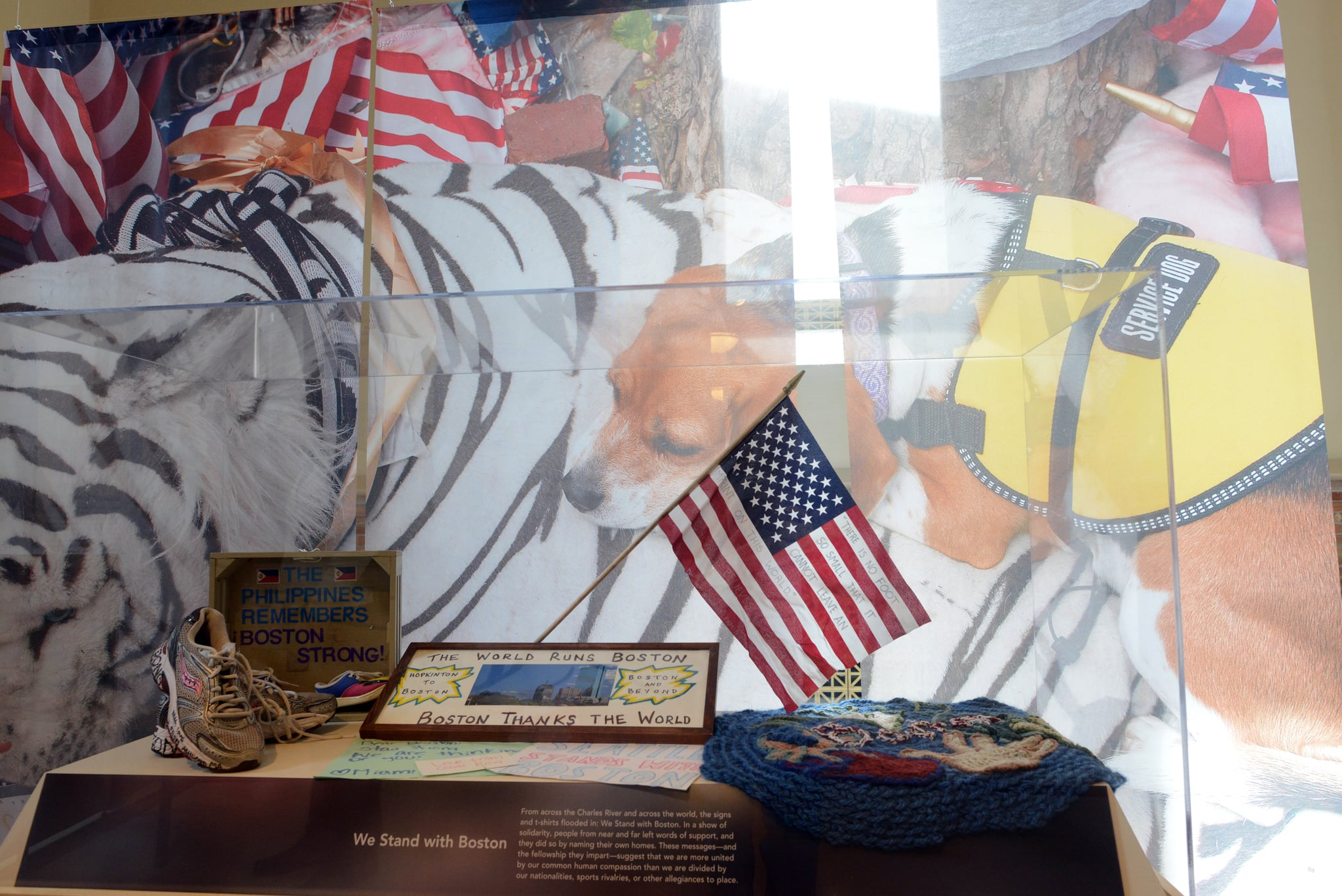 Objects from the Boston Marathon bombing are on display at the Boston Public Library's memorial exhibition.