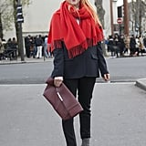 You hardly notice the suiting underneath the oversize scarf and beside the clutch.