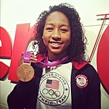Bronze medalist Lia Neal showed off her newest accessory at the offices of Teen Vogue. Source: Instagram user teenvogue
