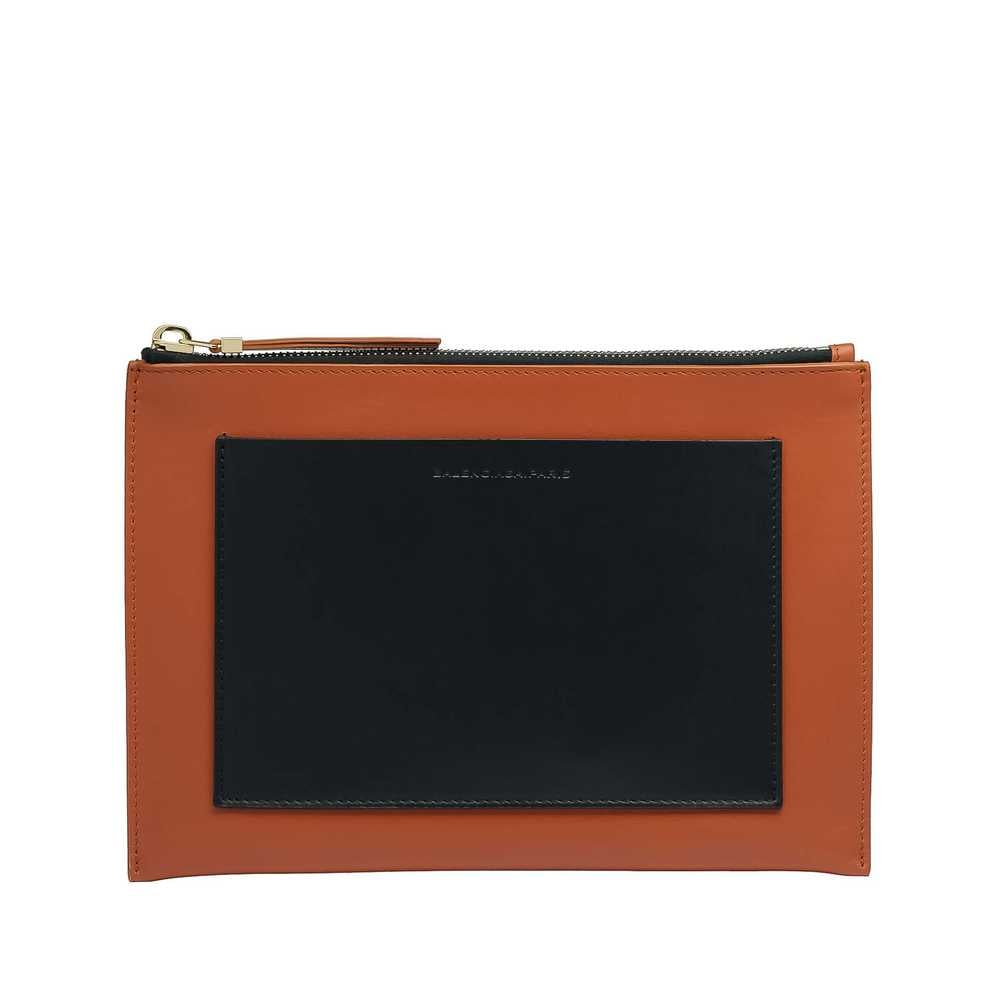 For the fashion lover who has everything, a little piece of Balenciaga never hurts. They have tons of small leather goods at lower price points, but I'm especially smitten with the structured pouch ($345), which can function as the chicest clutch. — Noria Morales, style director