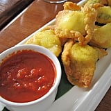 The Bajan take on mozzarella sticks involves goat cheese and won ton wrappers; classic marinara sauce is on the side.
